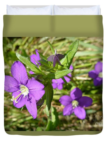 Duvet Cover featuring the photograph Small Mauve Flowers by Jean Bernard Roussilhe