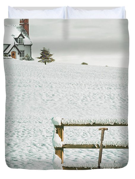 Spade Leaning Against Fence In The Snow Duvet Cover