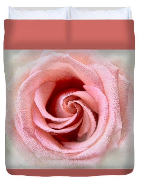 Duvet Cover featuring the photograph Spinning Coral Rose by Bonnie Willis