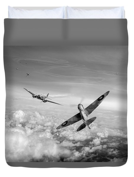 Duvet Cover featuring the photograph Spitfire Attacking Heinkel Bomber Black And White Version by Gary Eason