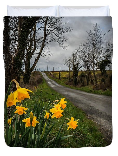 Duvet Cover featuring the photograph Spring Daffodils On An Irish Country Road by James Truett