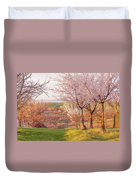 Duvet Cover featuring the photograph Spring Orchard With Morring Sun by Jenny Rainbow