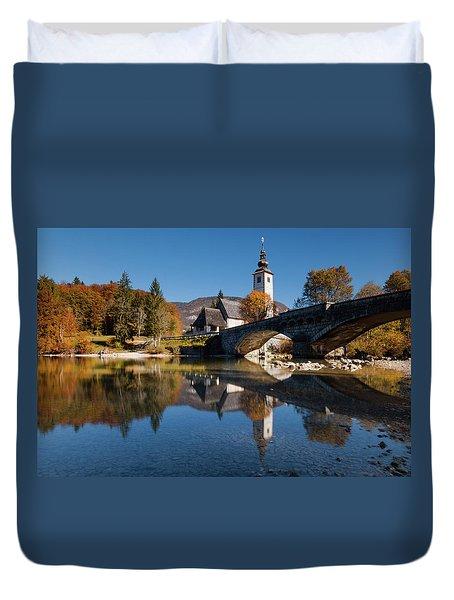 Duvet Cover featuring the photograph St. John The Baptist On The Lake Bohinj by Davor Zerjav
