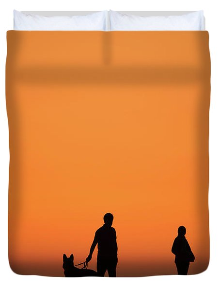 Standing At Sunset Duvet Cover