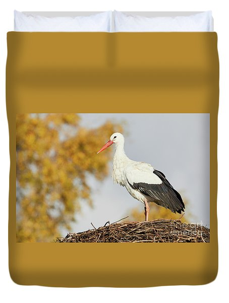Duvet Cover featuring the photograph Stork On A Nest, Trees In The Background by Nick Biemans