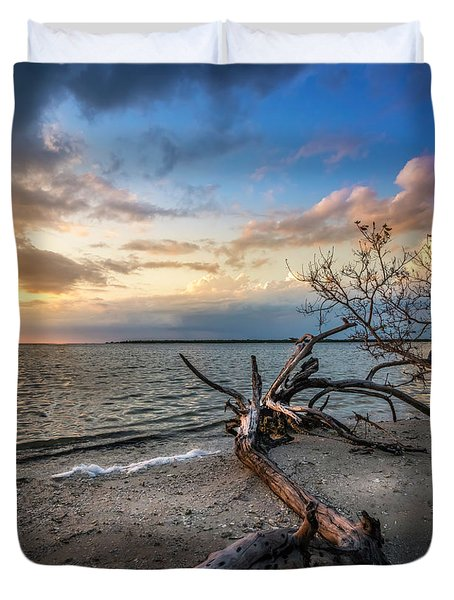 Duvet Cover featuring the photograph Stormy Sunset by Marvin Spates
