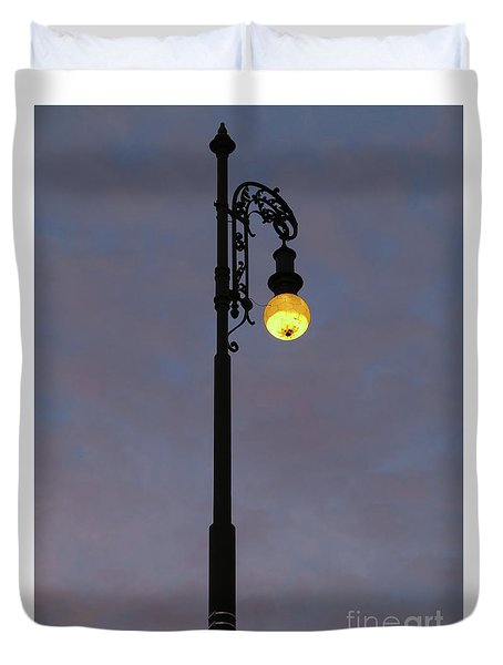 Duvet Cover featuring the photograph Street Lamp Shining At Dusk by Michal Boubin