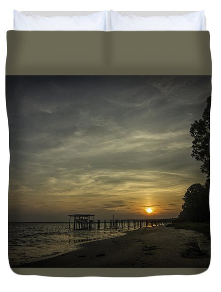 Sun Going Down Behind Dock Duvet Cover