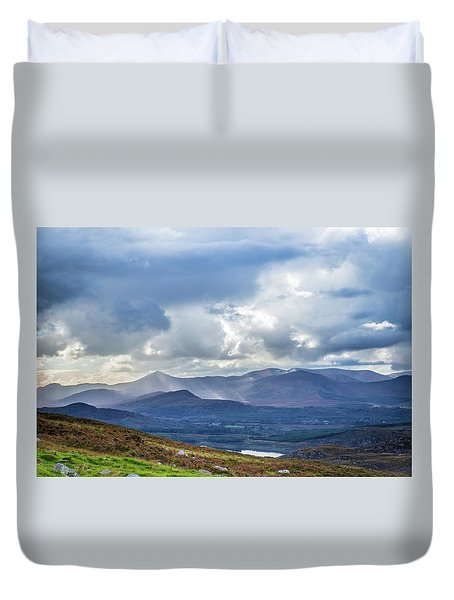 Duvet Cover featuring the photograph Sun Rays Piercing Through The Clouds Touching The Irish Landscap by Semmick Photo