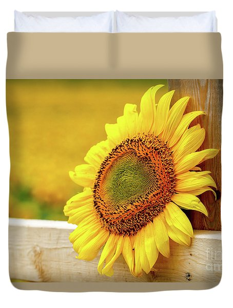 Sunflower On The Fence Duvet Cover by Eleanor Abramson