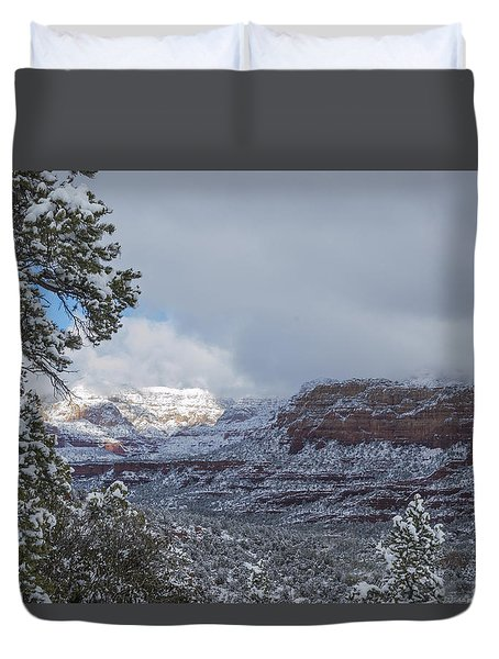 Duvet Cover featuring the photograph Sunlit Snowy Cliff by Laura Pratt