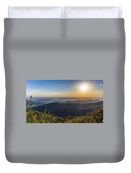 Duvet Cover featuring the photograph Sunrise Over The Misty Mountains by Lori Coleman