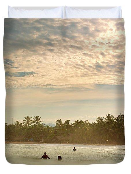 Sunrise Surfers Duvet Cover