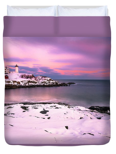 Duvet Cover featuring the photograph Sunset At Nubble Lighthouse In Maine In Winter Snow by Ranjay Mitra