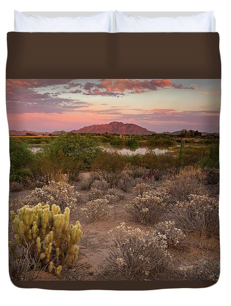 Sunset At The Oasis Duvet Cover by Sue Cullumber