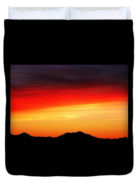 Duvet Cover featuring the photograph Sunset Over Santa Fe Mountains by Joseph Frank Baraba
