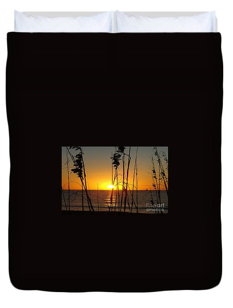 Sunset Through The Grass Duvet Cover by Rod Jellison