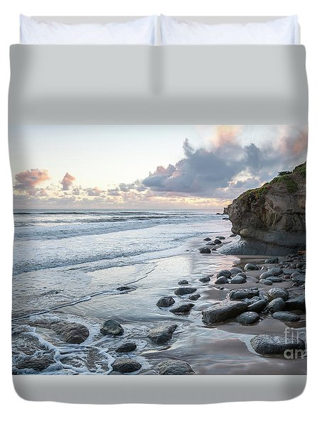 Sunset View In The Distance With Large Rocks On The Beach Duvet Cover