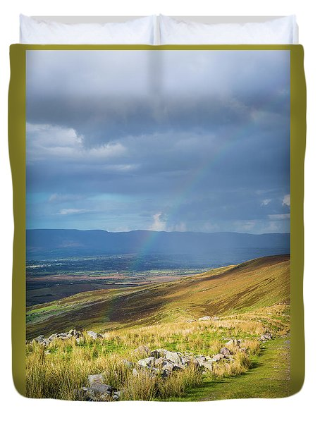 Duvet Cover featuring the photograph Sunshine And Raining Down With Rainbow On The Countryside In Ire by Semmick Photo