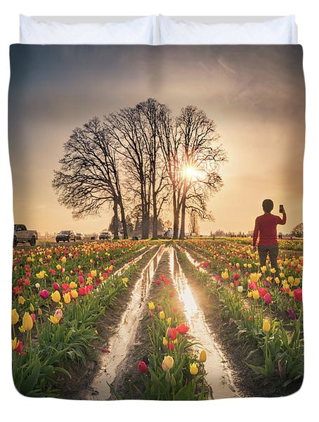 Duvet Cover featuring the photograph Taking Sunset Pictures Using A Mobile Phone by William Lee