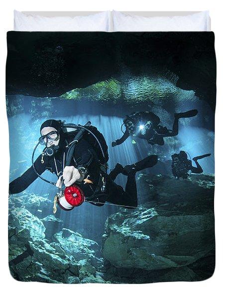 Technical Divers Enter The Cavern Duvet Cover by Karen Doody