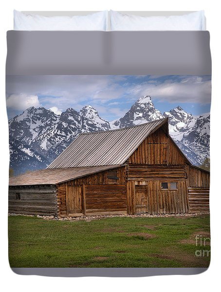 Tetons Towering Over The Moulton Barn Duvet Cover by Adam Jewell