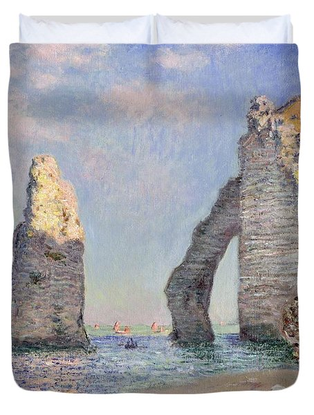 The Cliffs At Etretat Duvet Cover by Claude Monet