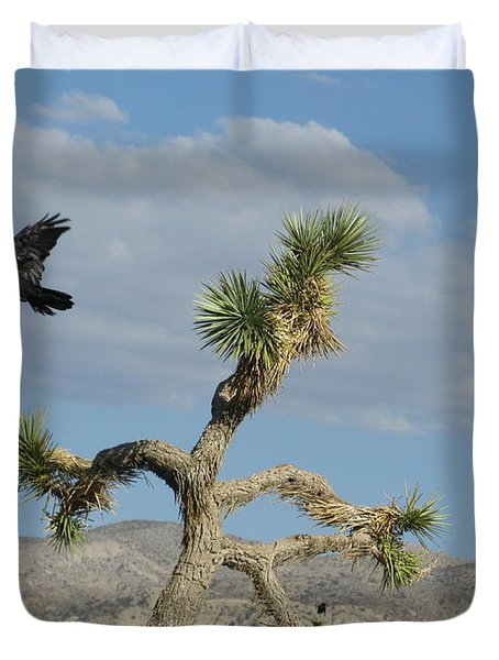 Duvet Cover featuring the photograph The Flight Of Raven. Lucerne Valley. by Ausra Huntington nee Paulauskaite