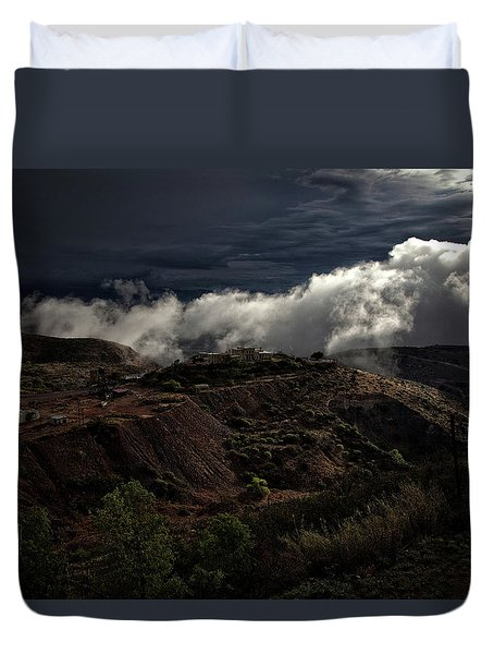 Duvet Cover featuring the photograph The Jerome State Park With Low Lying Clouds After Storm by Ron Chilston