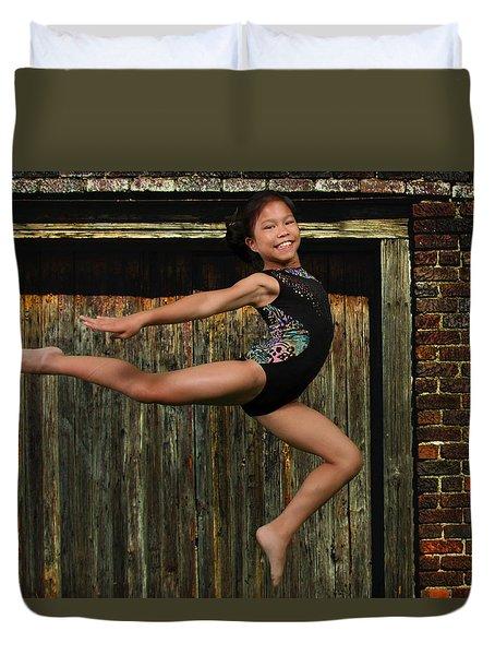 Duvet Cover featuring the photograph The Jump by Robert Hebert