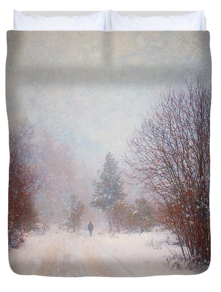 The Man In The Snowstorm Duvet Cover by Tara Turner
