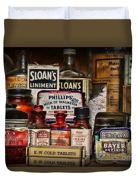The Medicine Shelf Duvet Cover by Paul Ward