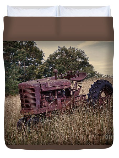 Duvet Cover featuring the photograph The Old Farmall by Laurinda Bowling