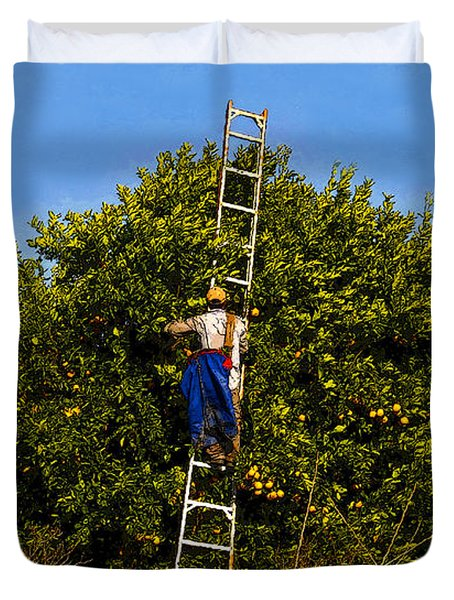 The Orange Picker Duvet Cover by David Lee Thompson