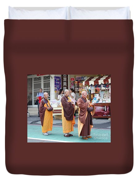 Duvet Cover featuring the photograph Three Buddhist Monks Chant Scriptures by Yali Shi