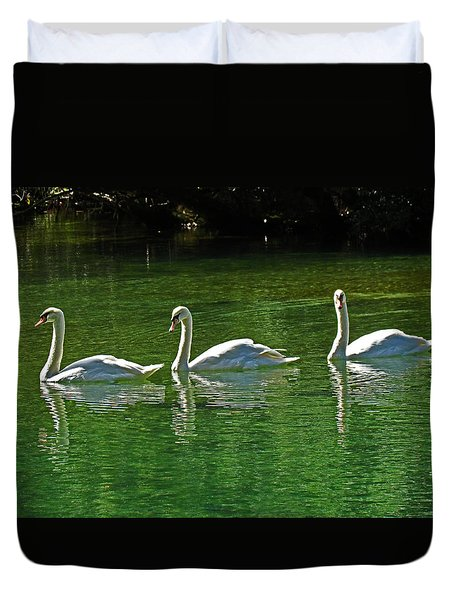 Three Swans Aswimming Duvet Cover