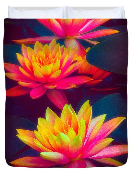 Duvet Cover featuring the photograph Three Waterlilies by Chris Lord