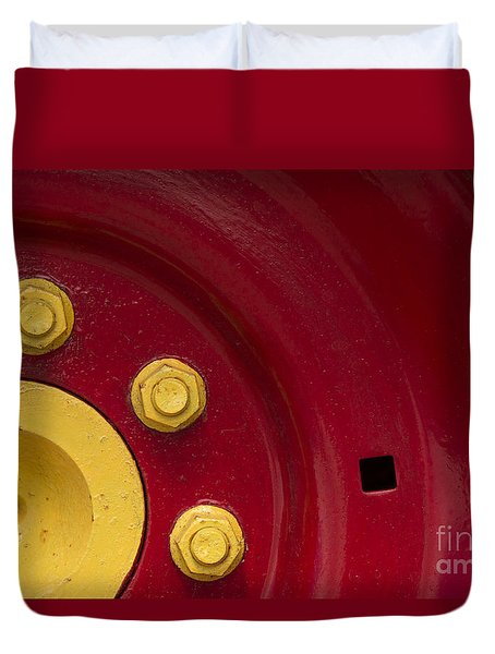Three Yellow Nuts On A Red Wheel Duvet Cover by Wendy Wilton