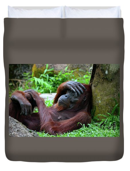Tired Female Orangutan Ape Rests Against Tree With Hand On Her Head Duvet Cover
