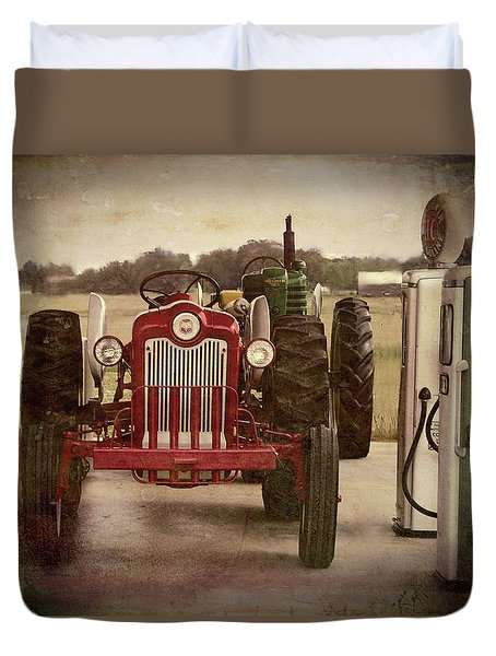 Duvet Cover featuring the pyrography Tractor And Gas Pumps by Bonnie Willis