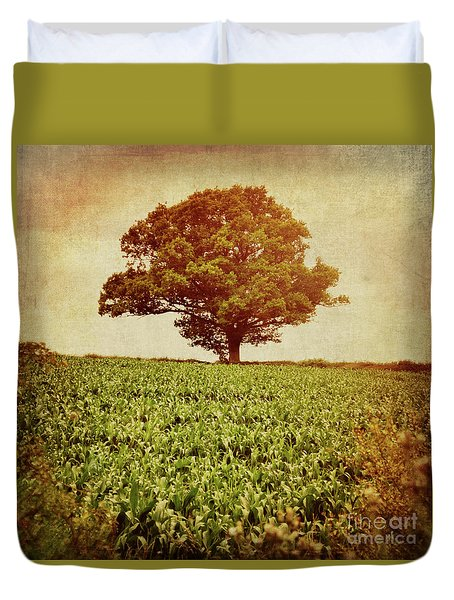 Duvet Cover featuring the photograph Tree On Edge Of Field by Lyn Randle