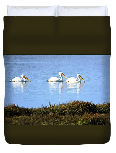 Duvet Cover featuring the photograph Tres Pelicanos Blancos by AJ Schibig