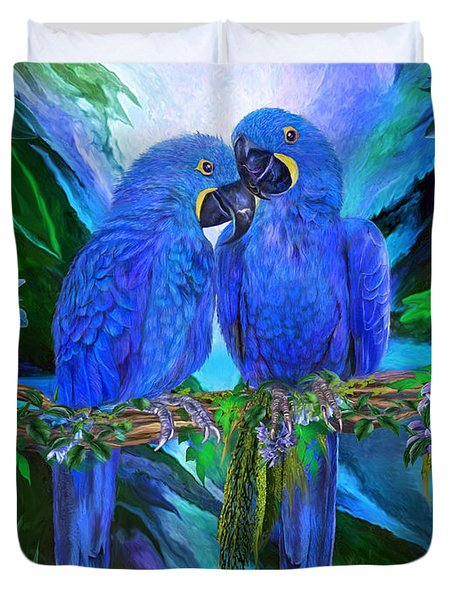 Duvet Cover featuring the mixed media Tropic Spirits - Hyacinth Macaws by Carol Cavalaris