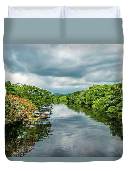 Cloudy Skies Over The River Duvet Cover