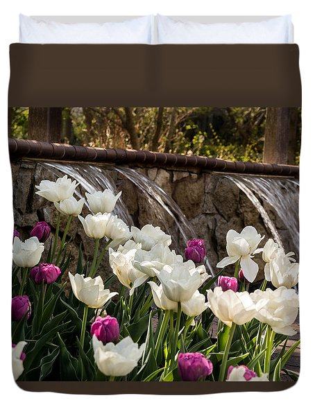 Duvet Cover featuring the photograph Tulips And Waterfall by Jay Stockhaus