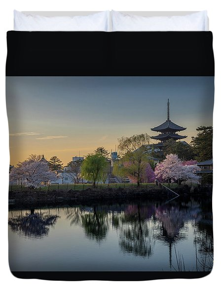 Duvet Cover featuring the photograph Twilight Temple by Rikk Flohr