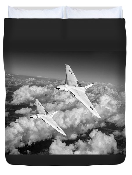 Duvet Cover featuring the photograph Two Avro Vulcan B1 Nuclear Bombers Bw Version by Gary Eason