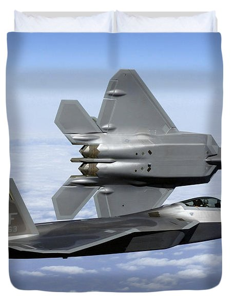 Duvet Cover featuring the photograph Two F-22a Raptors In Flight by Stocktrek Images