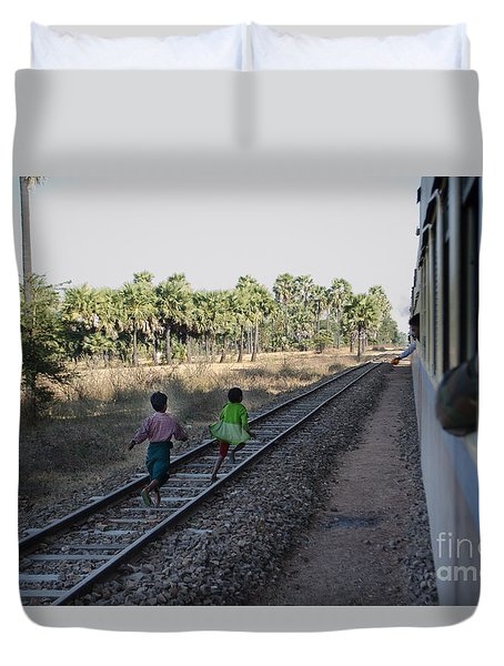 Duvet Cover featuring the photograph Two Kids Run Along And Follow Train In Burma by Jason Rosette