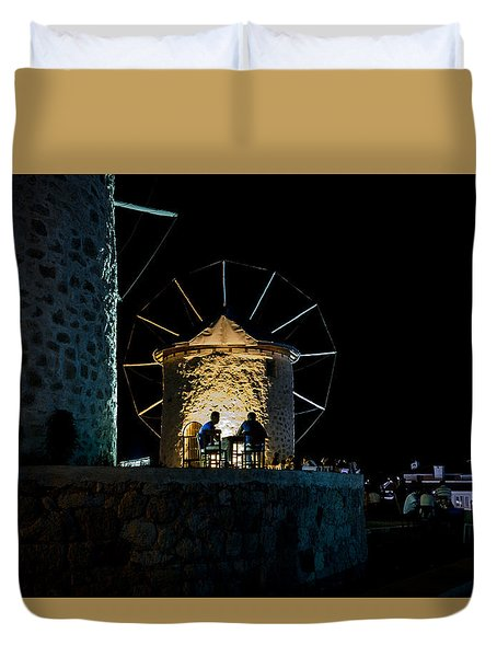 Two Men Eating By The Alacati Windmills Duvet Cover